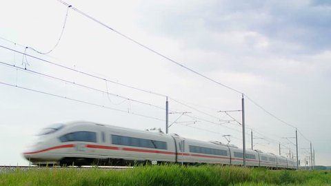KAMPEN, THE NETHERLANDS: JUNE 7, 2012: German high speed ICE train (Intercity-Express) driving on a railroad track in the countryside.