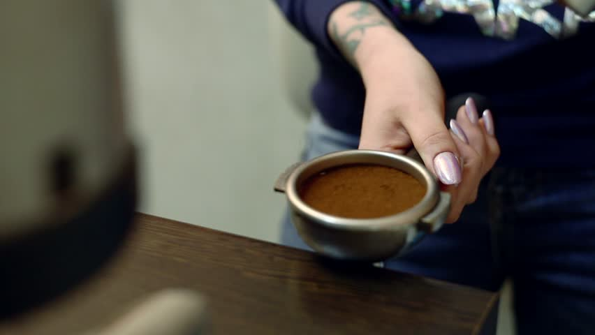 The girl prepares coffee behind the bar. A woman pours a Cup of coffee. | Shutterstock HD Video #29246746