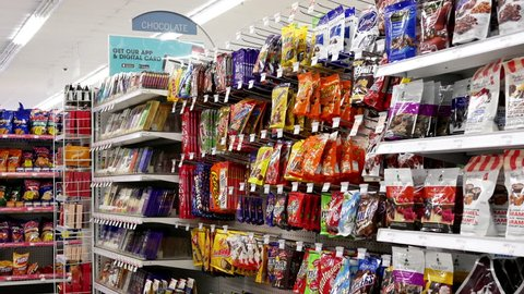 Coquitlam, BC, Canada - July 26, 2017 : Motion of display chocolate and candy corridor in shopper drug mart store with 4k resolution