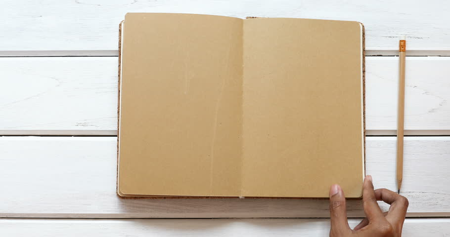 A male hand open diary brown paper 6 page then close  on the white wooden desk, top view and overhead shot use for blank template book mock up to add any text content, 4K Dci resolution | Shutterstock HD Video #29323726