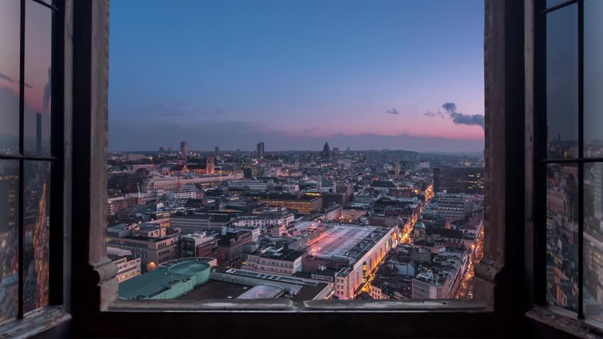 city skyline seen through a window timelapse day to night
