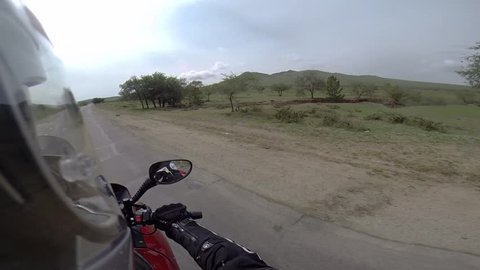 motorcyclist driving on steppe
