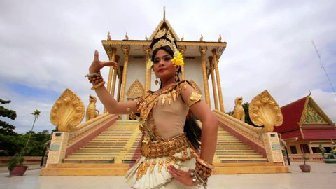Apsara Dancer beautifully centered in front a temple