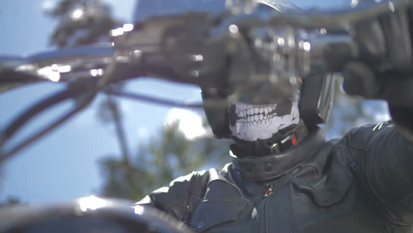 A bikers portrait. Head covered by a helmet and a mask. #29391916