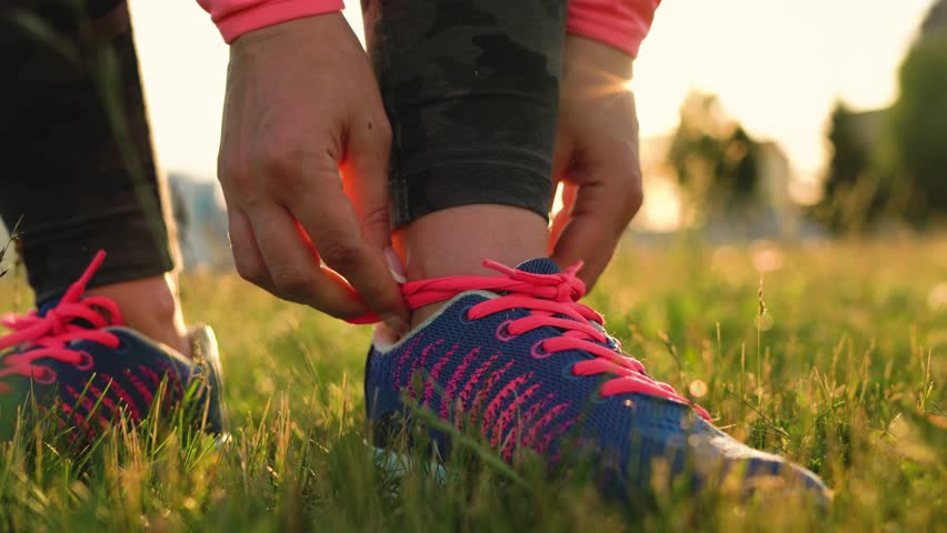 Running shoes - woman tying shoe laces | Shutterstock HD Video #29405086