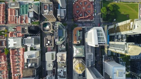 SINGAPORE - MAY 2017: Overhead aerial view of streets and skyscrapers in central business district Singapore, contrast with historic market building