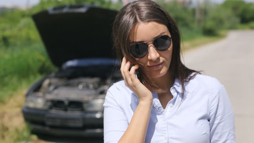 Happy smiley girl in sunglasses reading ebook and drinking tea in young attractive stylish pretty woman near broken car speaking at smartphone needs assistance hd stock fandeluxe Ebook collections