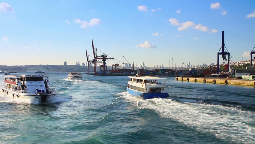 Istanbul ferry boats sailing in front of Haydarpasa docks