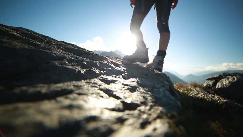 Hiker boots closed up, mountain range Hiker boots closed up on mountain peak at sunset | Shutterstock HD Video #29489632