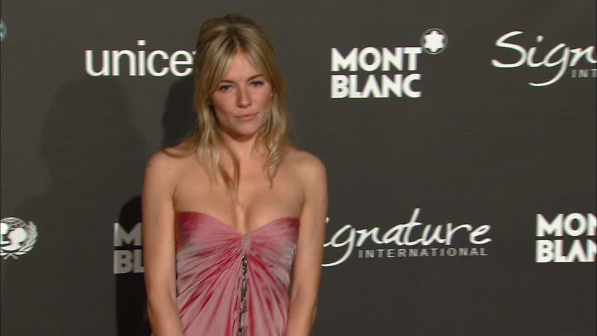 Hollywood, CA - FEBRUARY 20, 2009: Sienna Miller, walks the red carpet at the Signature For Good Gala held at the Paramount Studios