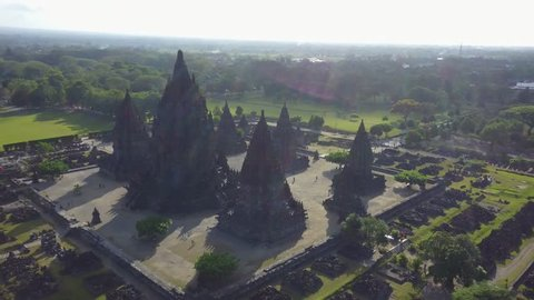 Beautiful aerial landscape footage of Prambanan temple complex from a drone flying spinning around the temple in Yogyakarta, Indonesia. Shot in 4k resolution