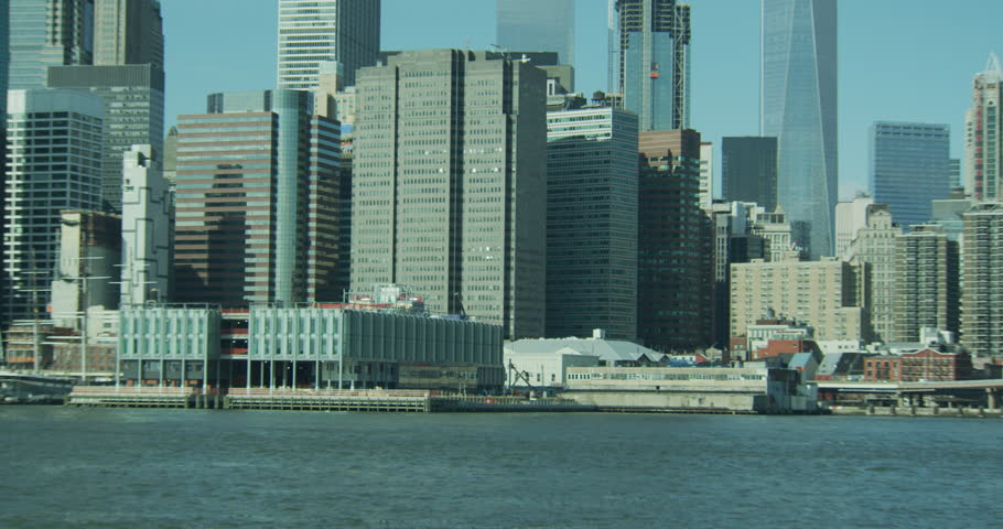 Day from Brooklyn side hold south seaport area then tilt up left along New York skyline, Manhattan skyline | Shutterstock HD Video #29547226