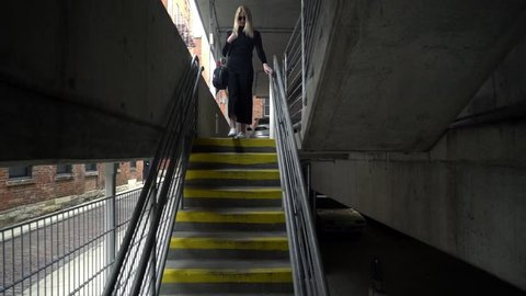 Three Angles Three in One Edit of Young Caucasian Female Model Walking Down Stairs in Sunglasses and Fashion Stylist Minimalist Walking in Urban Parking Garage in Slow Motion