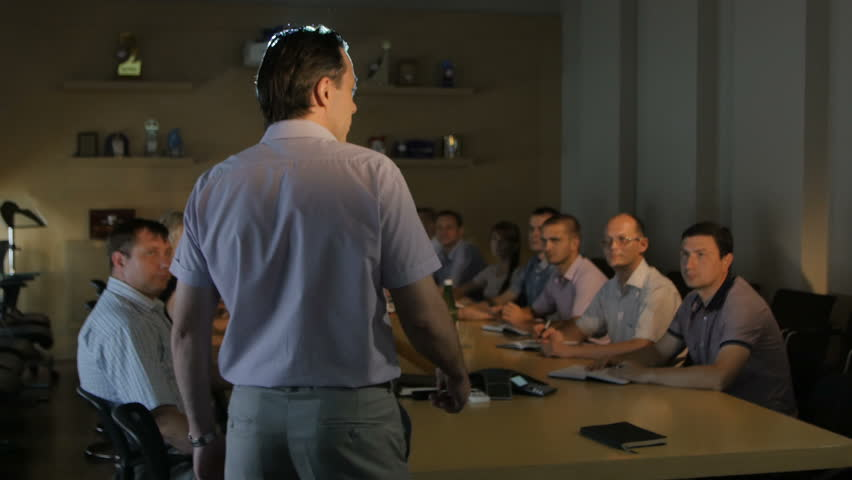 KAZAN, TATARSTAN/RUSSIA - MAY 11 2016: Backside view professional lector explains project details to audience at screen against projector light on May 11 in KAZAN | Shutterstock HD Video #29555104