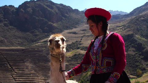 Native Peruvian girl with her Llama in Sacred Valley, Cusco, Peru