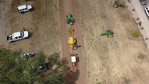 MONTICELLO, UTAH - 24 JUL 2017: Aerial overhead antique tractor pull demonstration. Rural farming community is agriculture based economy. Old and historic tractors in use on farms. City celebration.