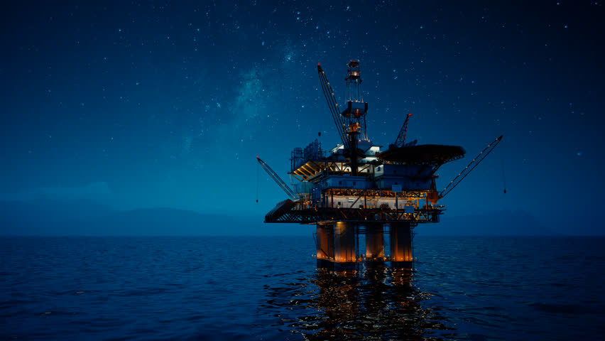 02876 View of an Oil rig at night. Milky way shines above.