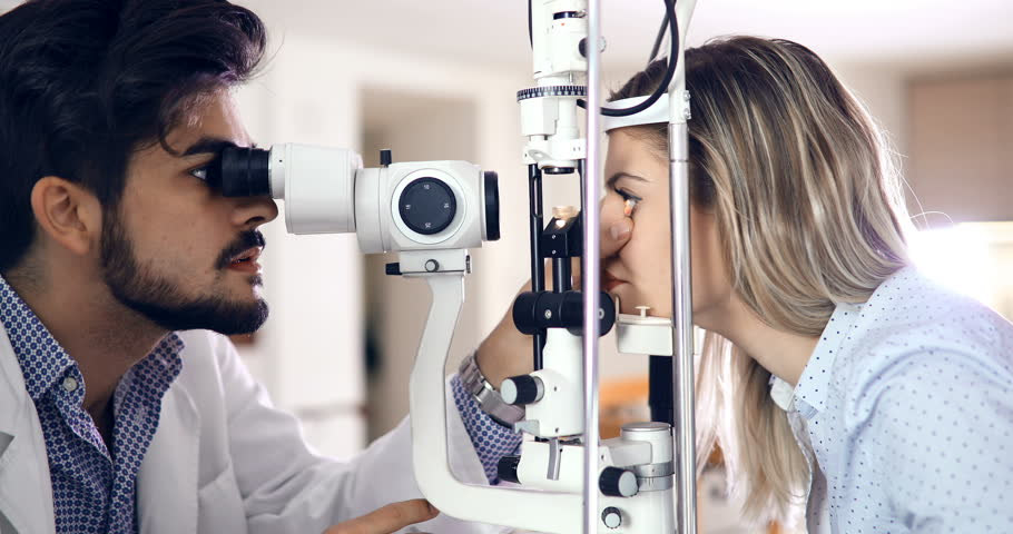 optometrist checking patient eyesight and vision correction #29634646