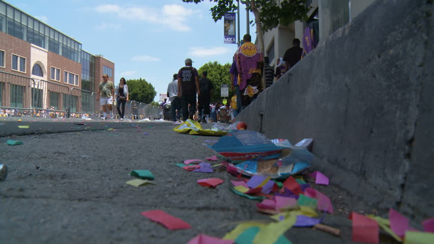 Walking Through Gutter Confetti. Some of the mess left on the street following the 2010 LA Lakers Championship parade on June 21st, 2010, Los Angeles, California.