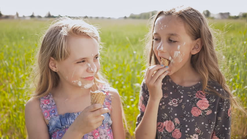 Two Girls Sister Eat Ice Cream In The Summer Next To A Field Village Face Is Soaked Funny Episode