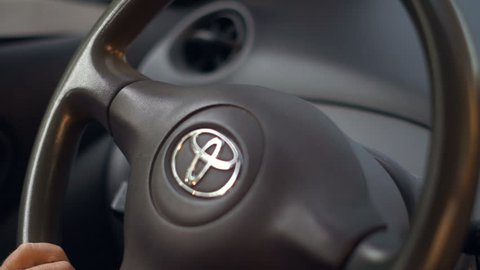 MONTREAL, CANADA - JULY 2017: Close up of Toyota automobile steering wheel during a sunny morning