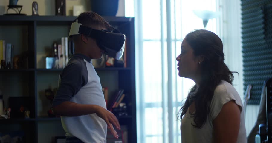 Slow Motion of Woman having fun watching her Son play with Virtual Reality headset | Shutterstock HD Video #29677606