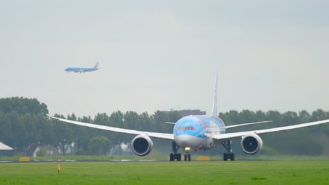 AMSTERDAM, THE NETHERLANDS - JULY 25, 2017: TUI Fly Dreamliner Boeing 787 PH-TFM accelerate before take-off at Polderbaan 36L, Shiphol Airport, Amsterdam, Holland