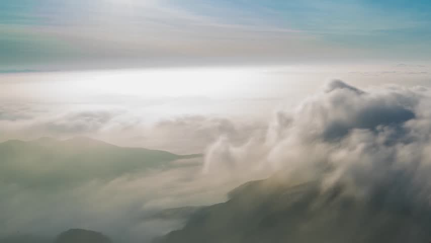 TIME LAPSE CLOUDS ROLLING IN MOUNTAIN, WHITE FOG CLOUDS TIME LAPSE. AERIAL View of avalanche on Tordrillo snowy mountain peak. | Shutterstock HD Video #29723998