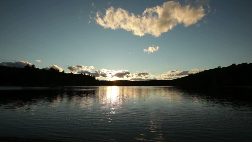 A wide angle view of sunset on Walden Pond in Concord, Massachusetts