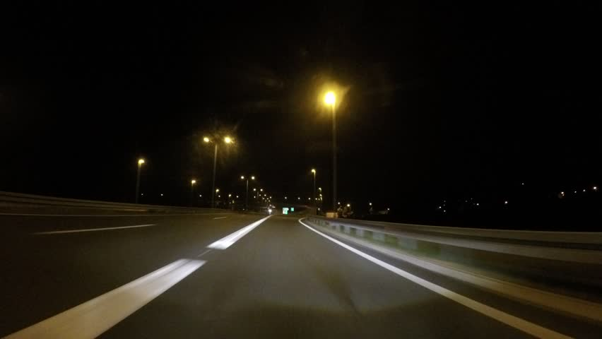 Driving car in fast lane at night on highway with adaptive headlights | Shutterstock HD Video #29753386