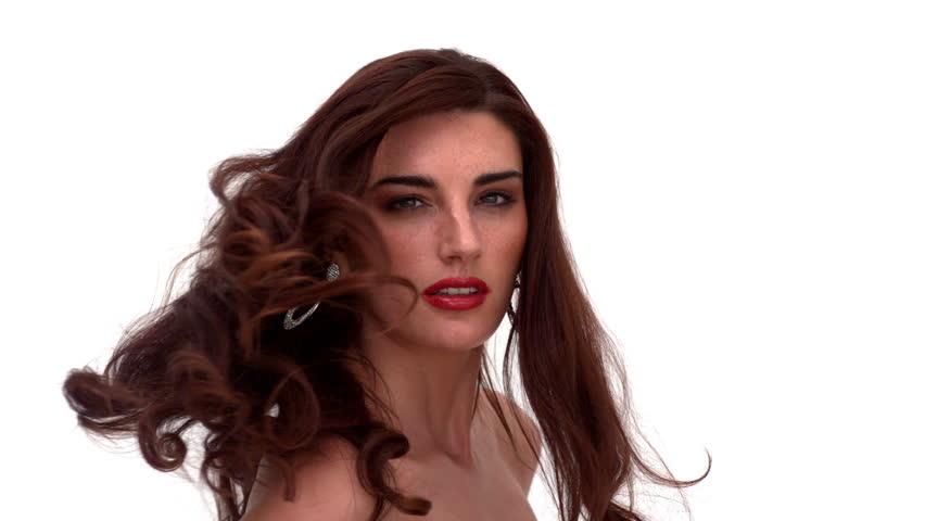 Glamorous woman turning around and shaking her hair