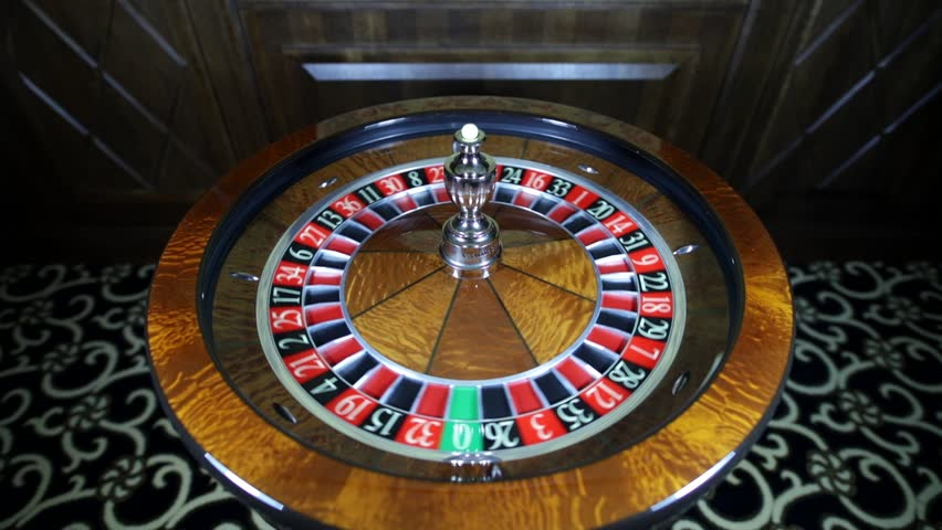 Spinning the ball. American Roulette wheel.