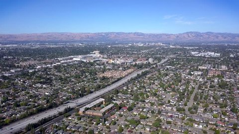 Ariel view of freeway with cars on it, Ariel view of San Jose California, 280 north freeway, 280 south freeway, Ariel view of homes next to freeway, Ariel view of neighborhood and trees.