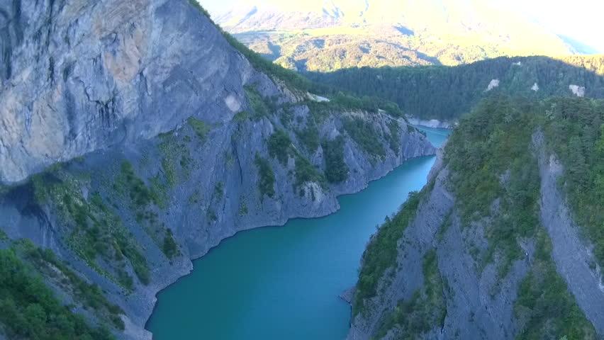Blue mountain lake with rope bridge near Grenoble, France  | Shutterstock HD Video #29802346