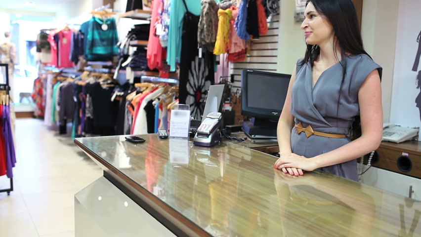 5d62e59ec3 hd00:15Woman buying clothes at till with credit card in clothes shop
