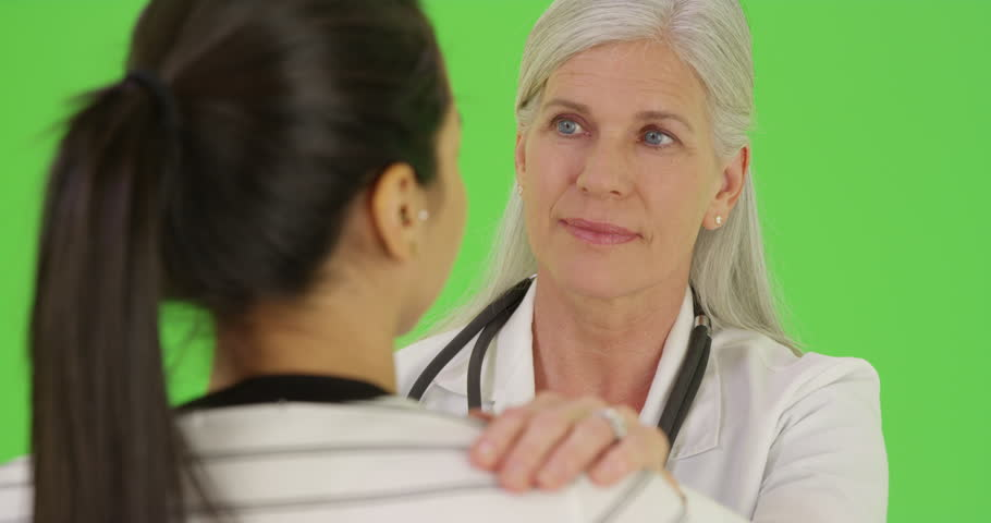 A smiling doctor talks to one of her patients on green screen. On green screen to be keyed or composited. on green screen. On green screen to be keyed or composited. #29817736