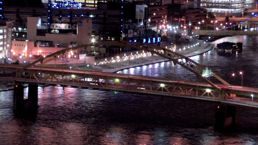Time-lapse of traffic passing over the Fort Duquesne Bridge. Close.
