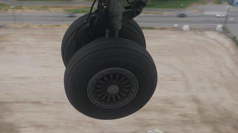 Airplane Wheel Landing on Tarmac, View from Window, 4K