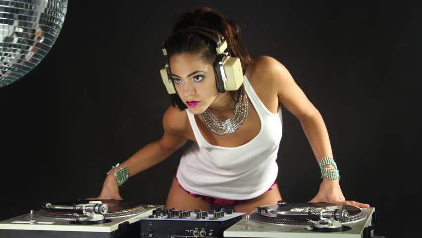a sexy female dj dancing and playing records
