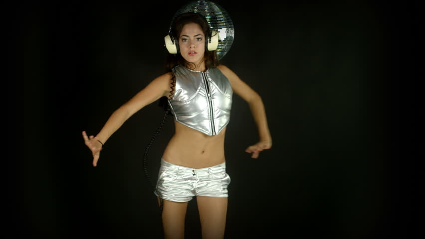 sensual studio shoot of a beautiful woman dancing in a silver outer space style costume