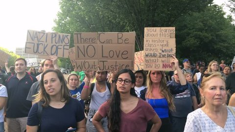 WASHINGTON, D.C. - Circa August, 2017 - Anti-hate protesters hold signs and chant outside The White House after the tragic events in Charlottesville, Virginia.