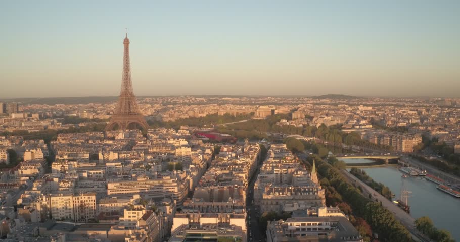 Aerial view of the Eiffel Tower and Paris at sunrise, 4K. Vue aérienne de la Tour Eiffel et de Paris au petit matin, 4K.