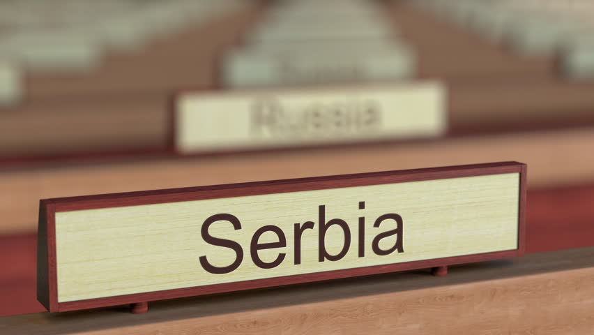 Serbia name sign among different countries plaques at international organization. 3D rendering