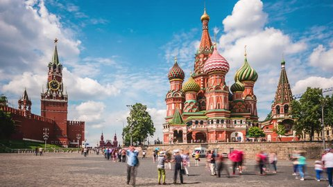 Moscow, Russia - July 26, 2017: Moscow Red Square, time lapse view of Kremlin and St. Basil's Cathedral in Moscow, Russia. Zoom in.