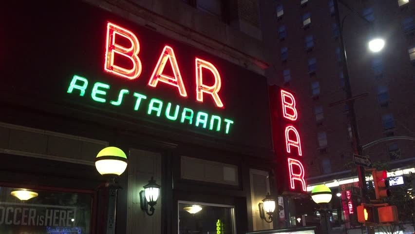 New York City Nighttime NX Establishing Shot CV of Bar Pub. Night exterior video footage of vintage neon sign. New York people go out at night to have fun, drink alcohol, go out on date, get together | Shutterstock HD Video #29928256