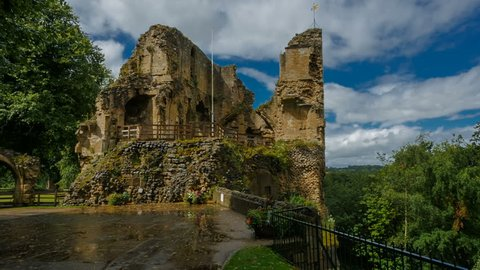 Panning shot of the Knaresborough Castle progressively lit by beautiful sunlight against a dramatic sky in Yorkshire, England, UK