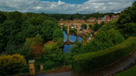 Ultra wide establishing shot of the medieval town of Knaresborough, Yorkshire, England, UK showing the railway viaduct and river Nidd