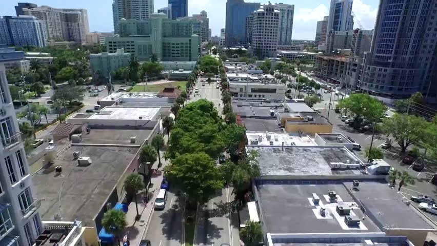 Calm street road in downtown modern architecture tall buildings of Florida cityscape in beautiful aerial 4k drone view