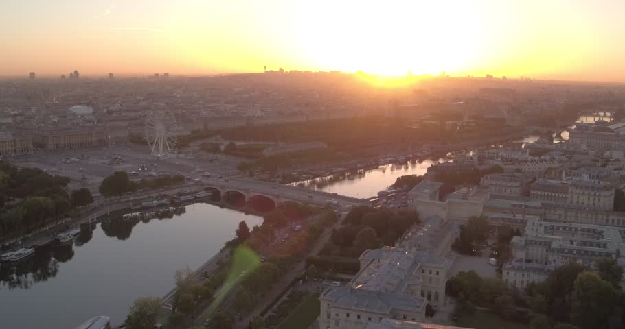 Aerial view of Paris and the Seine river at sunrise with Place de la Concorde and bridge, 4K. Vue aérienne de paris au matin, avec vue sur le Place de la Concorde à Paris, 4K
