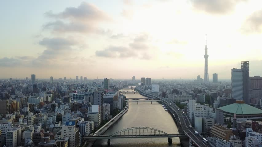 Aerial : Drone shooting of the landscape in Tokyo city Japan backward view Tokyo sky tree and the river and the bridge and roadway | Shutterstock HD Video #30014530
